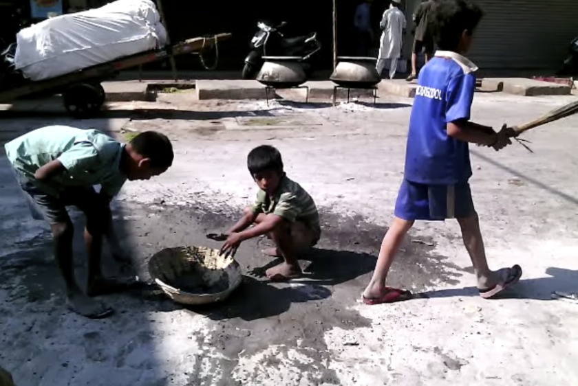 Child labourers on the street (still from film taken 2014), photo courtesy of the Artist and PAULNACHE, photo by Sanjay Theodore.